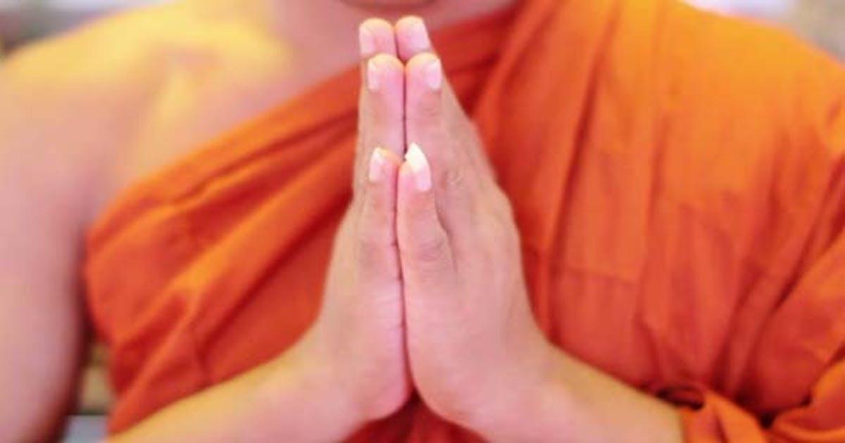 Buddhist Monk With Orange Robe Pray in Temple