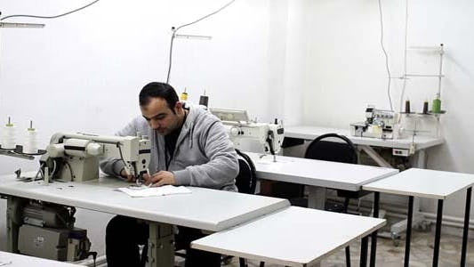 Thumbnail for Textile Factory People Sewing