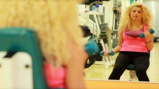 Thumbnail for Girl Using Dumbbells In A Gym