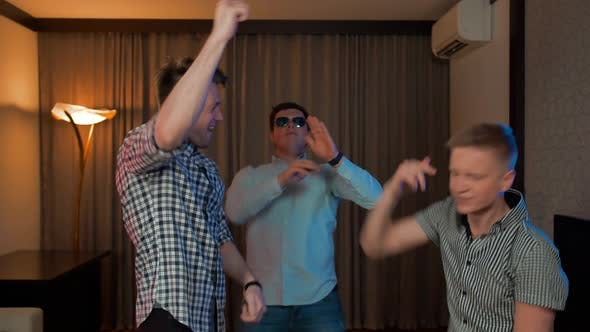 Group of Guys Dancing in the Flat Home Living Room