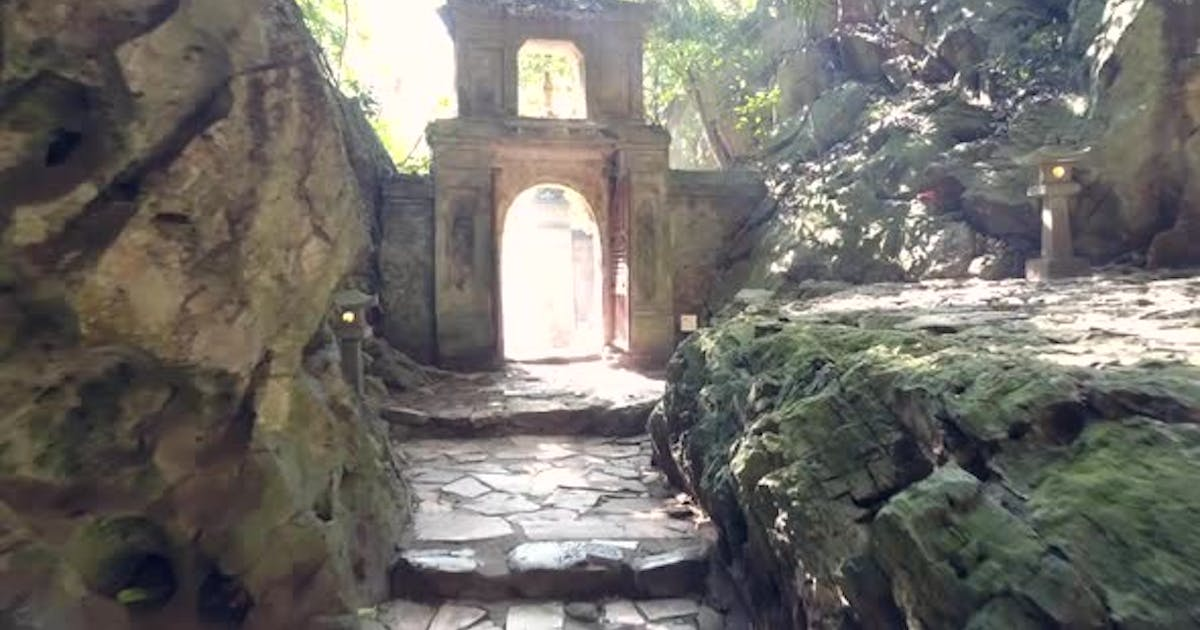 Motion Along Rocky Walls To Stone Arch Gate in Old Cave