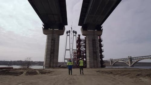 Engineers Examining Bridge Construction Site