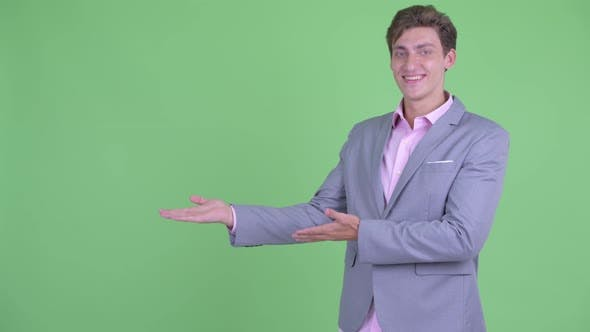 Thumbnail for Happy Young Businessman Showing Something