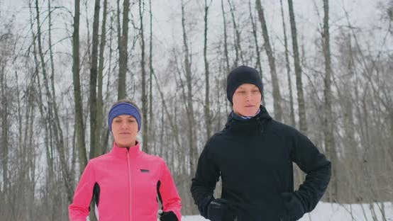 Thumbnail for Positive Beautiful Young Healthy Couple Running with Sportswear Through the Forest