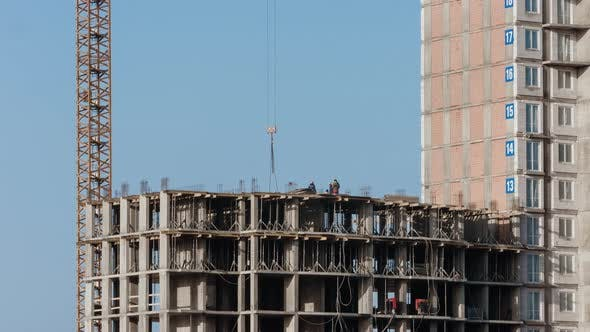 Thumbnail for Crane Working on Construction Site Residential Housing Building in City Constructors Working Sunny