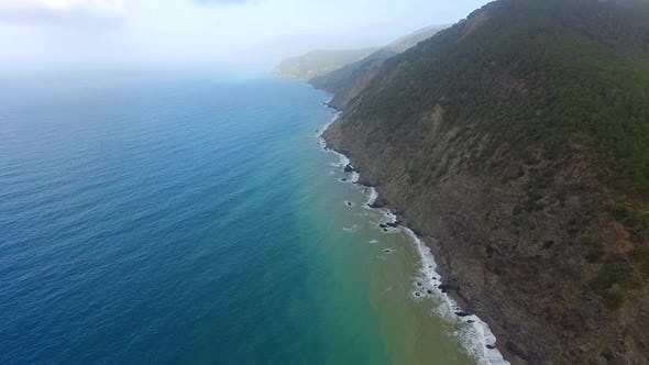 Thumbnail for Aerial Fly Over High Rocky Cliff Coast