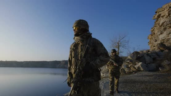 Thumbnail for Armed Soldiers Walking in Single File at Sunset