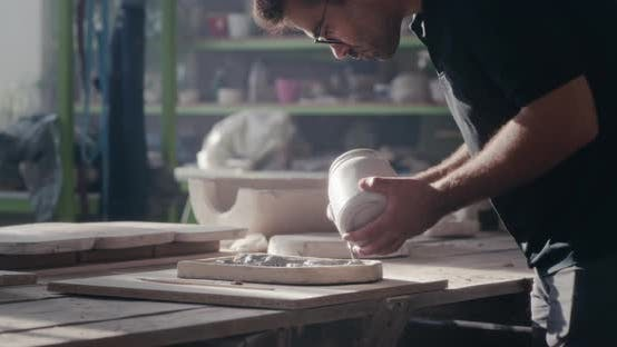 Thumbnail for Male Ceramist Painting Handicraft in Studio