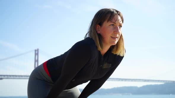 Cover Image for Female Athlete Taking a Break During Workout