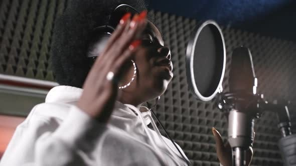 Cover Image for Female Musician Singing Song in Recording Studio