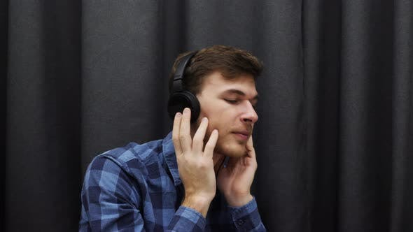 Thumbnail for Man in headphones listening to music