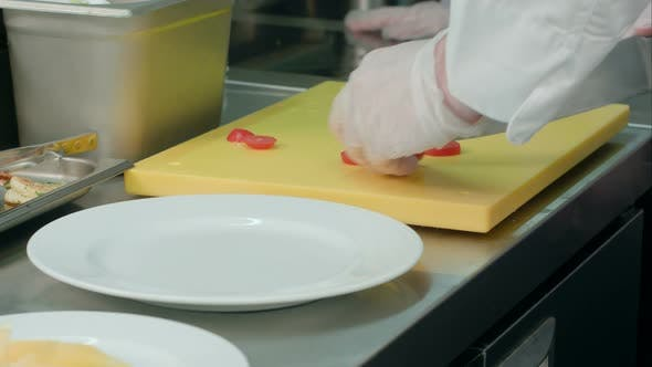Thumbnail for Chef's Male Hands Cutting Tomatoes on a Chopping Board