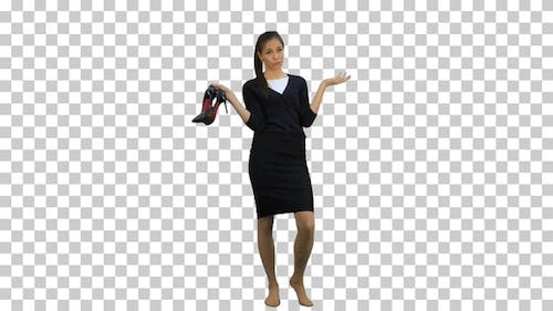 Tired young businesswoman standing barefoot, Alpha Channel