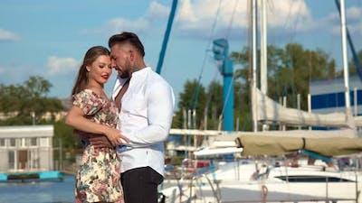 Happy Stylish Couple Hugging in Harbor