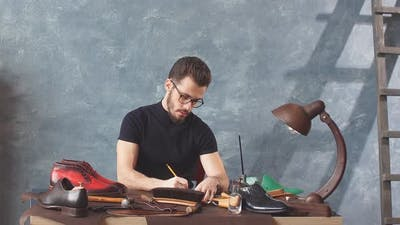 Young Creative Shoemaker Inventing Stylish Shoes