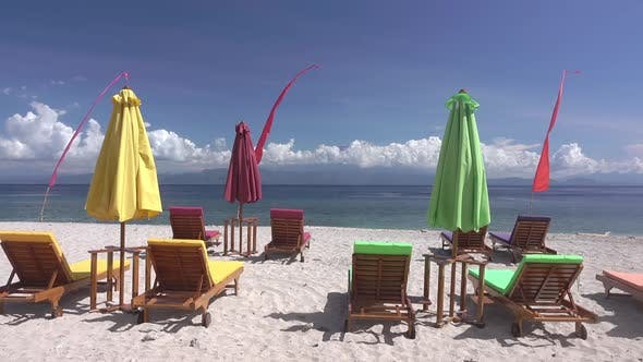 Thumbnail for Empty Sunbeds and Umbrellas on the Beach