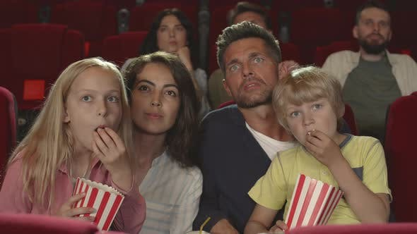 Thumbnail for Family Watching Horror in the Cinema