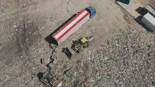 Garbage Truck and Industrial Bulldozer on Waste Landfill