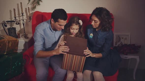 Happy Family Open Christmas Present Parents Shocked