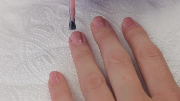Thumbnail for Young Woman Paints Her Nails with Natural Pink Gel Base. Nails Manicure. Close Up Hands