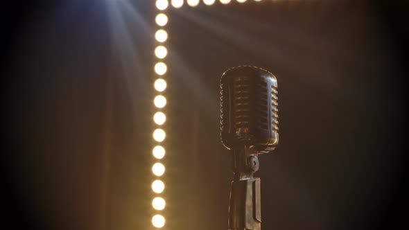 Thumbnail for Microphone on Stage with Smoke Anding Light Behind It. Professional Concert Vintage Glare Microphone