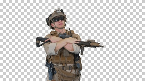 Tired US marine with a assault rifle standing, Alpha Channel