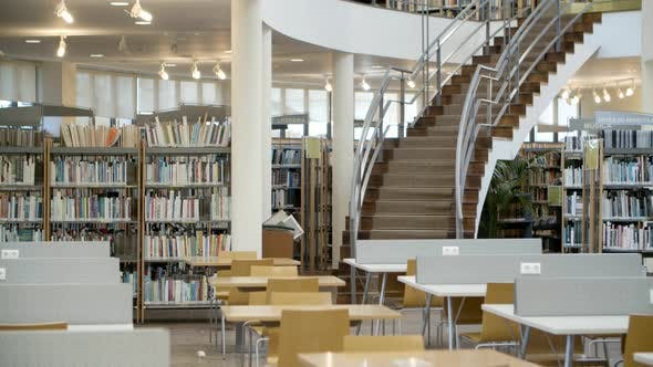 Interior of Library with Books on Shelves and Stairs