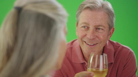 Thumbnail for Mature middle aged male drinking wine with his female friend