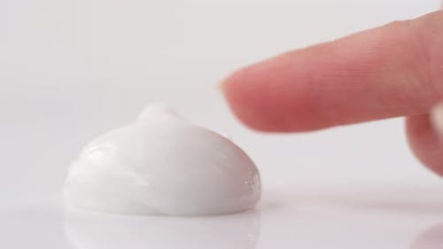 Taking Cosmetic Cream with Finger