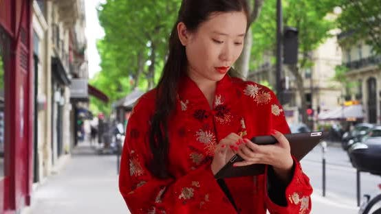 Thumbnail for Close up of millennial woman typing on portable tablet computer in Paris France
