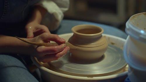 Ceramist Carves Patterns on a Vase. Home Hobby