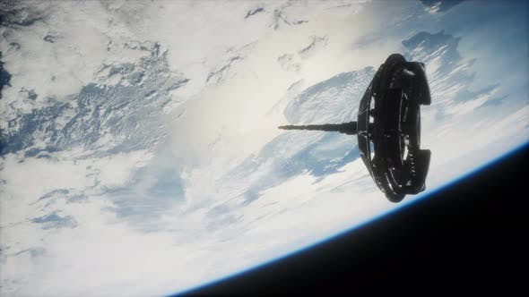 Thumbnail for Futuristic Space Satellite Orbiting the Earth