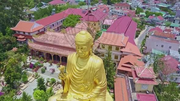 Thumbnail for Golden Buddha Sculpture Face Against Temple Complex