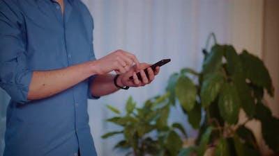 Man Surfing the Internet on Smartphone