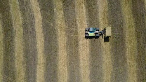 Tractor Collecting Straw