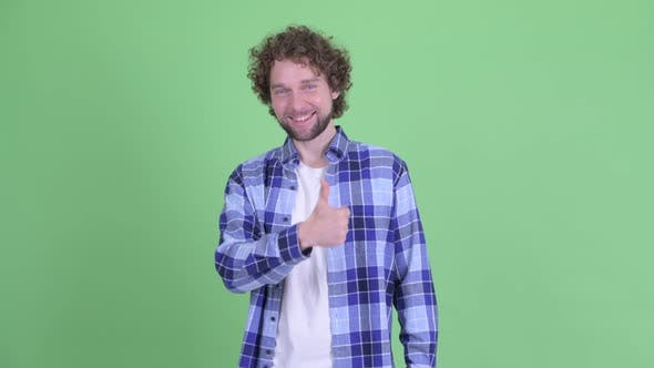 Thumbnail for Happy Young Bearded Hipster Man Giving Thumbs Up