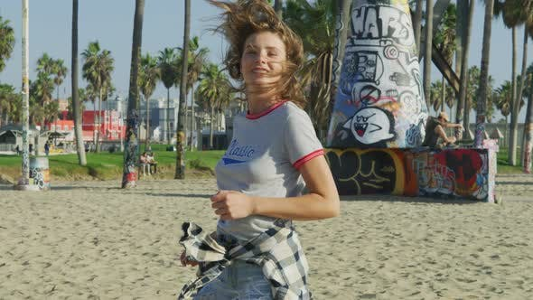 Thumbnail for Happy girl running in Venice Beach
