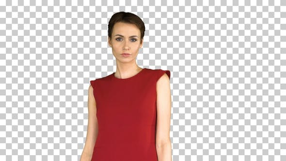 Cover Image for Girl in a red dress, posing, straightens her dress, Alpha Channel