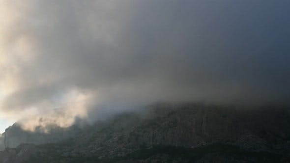 Thumbnail for Clouds Float on Top of a Mountain in Crimea