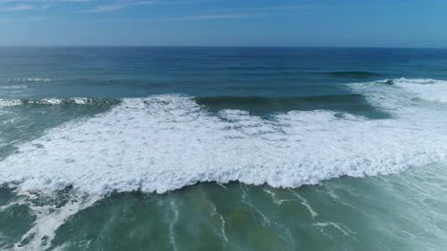 A Drone Flies Into the Open Sea Over Turquoise Water