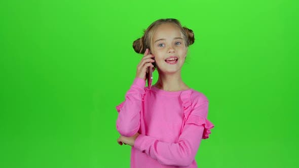 Thumbnail for Baby Is Talking on the Phone with Her Mom. Green Screen. Slow Motion