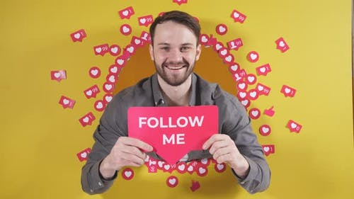 Happy Caucasian Man Cheerfully Asks to Subscribe to His Blog on the Internet Isolated By a Yellow