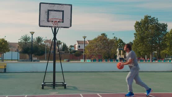 Thumbnail for Basketball Player Training. Playing on Basketball Field. Basketball Player Bouncing with the Ball.