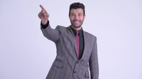 Thumbnail for Happy Bearded Persian Businessman Directing and Pointing Finger