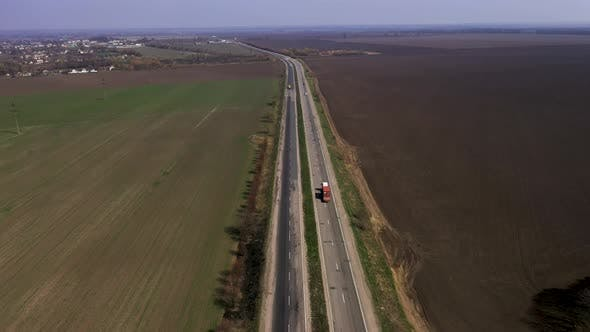 Aerial View of a Beautiful Highway Along The Fields