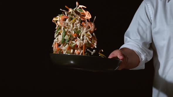 Thumbnail for Slow motion shot of chef with flaming stir fry; shot on Phantom Flex 4K at 1000 fps