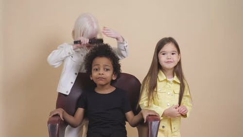 Funny Kids Combing Hair To Each Other