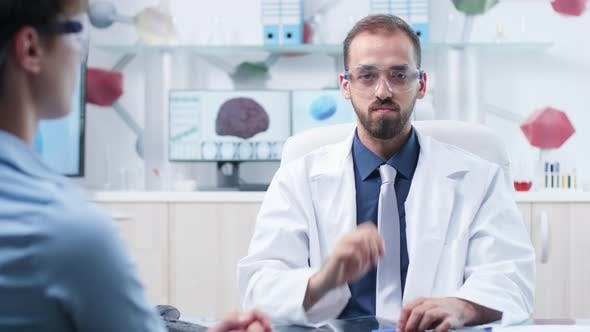 In Modern Research Facility Doctor Is Wearing Augmented Reality Glasses
