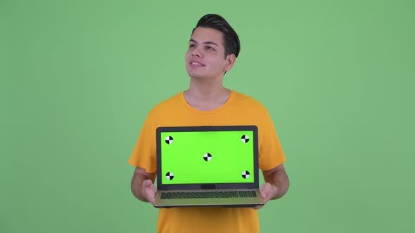 Thumbnail for Happy Young Multi Ethnic Man Thinking While Showing Laptop