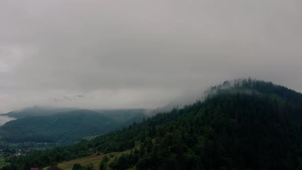 Thumbnail for Aerial View Over Foggy Mountains After Rain V5